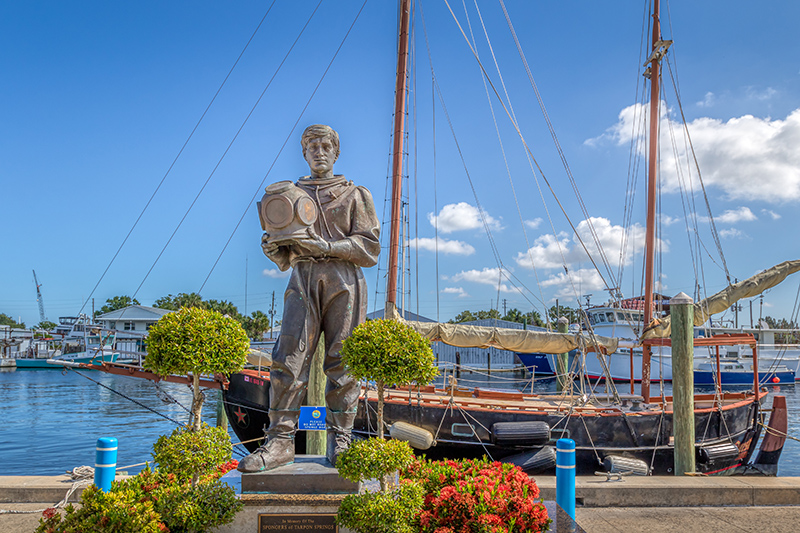 Tarpon Springs, Florida. A small historical waterside town with a sponge dock for boats and statue of a diver.